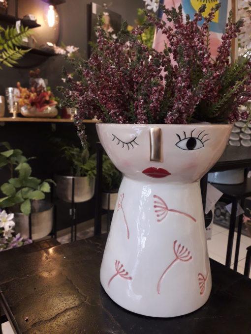 vase visage avec bruyère